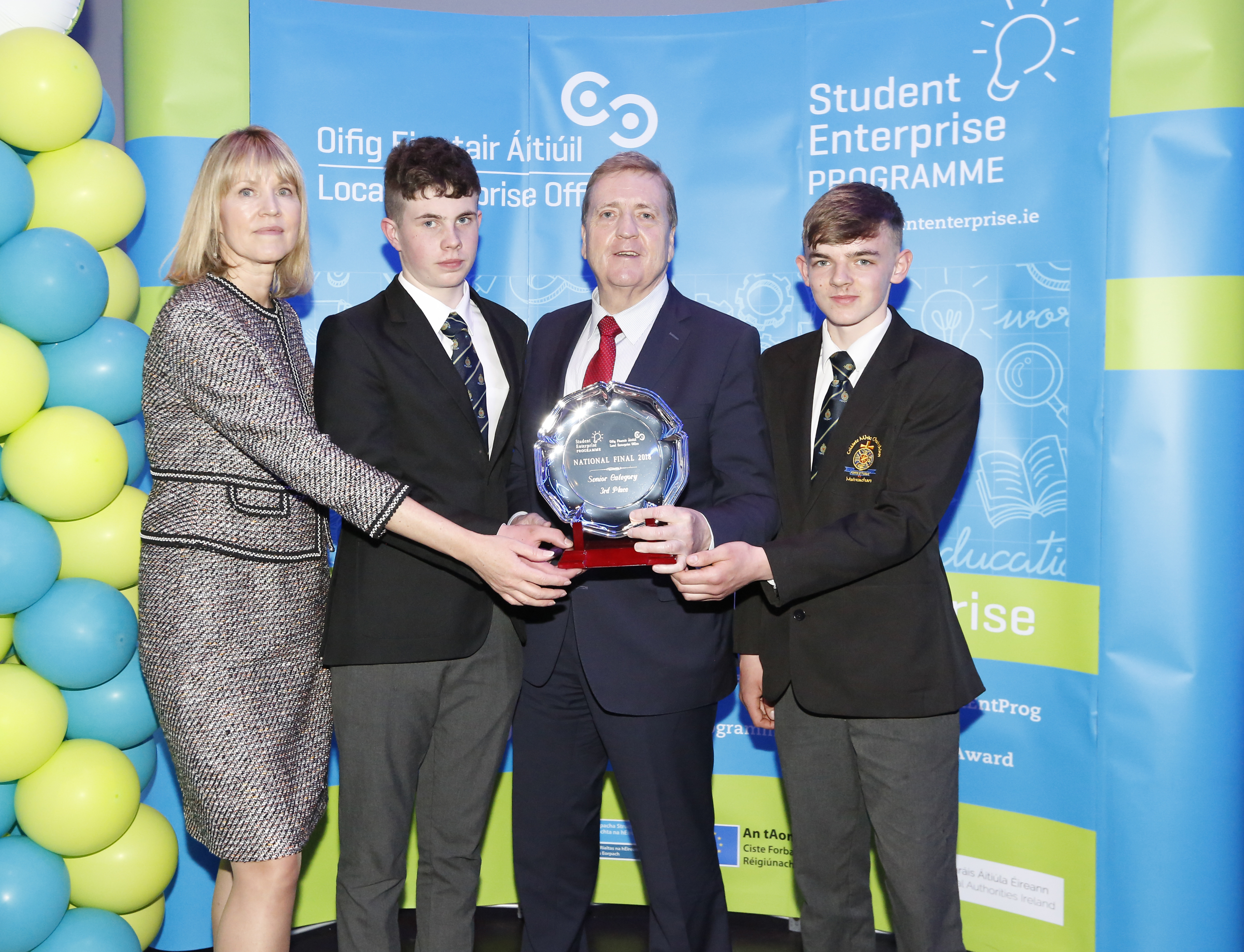 Minister-Pat-breen-presents-prize-to-students-from-St-Macartans-College-Monaghan