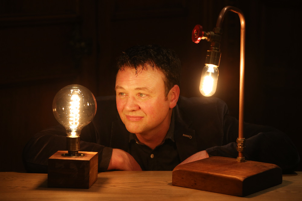 Eoin Shanley of Copper Fish Studio, having a light bulb moment at the launch of the Local Enterprise Office Showcase Award. Eoin uses locally sourced natural and upcycled materials to create unique, stylish and distinctive lamps and lighting at his Studios in Delgany.